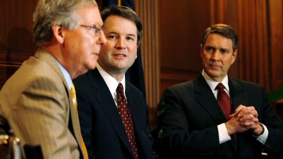 Kavanaugh is flanked by US Sens. Mitch McConnell, left, and Bill Frist during a news conference in Washington in May 2006. Kavanaugh had been nominated by Bush in 2003, but it took nearly three years until he was confirmed by a Senate vote of 57-36.