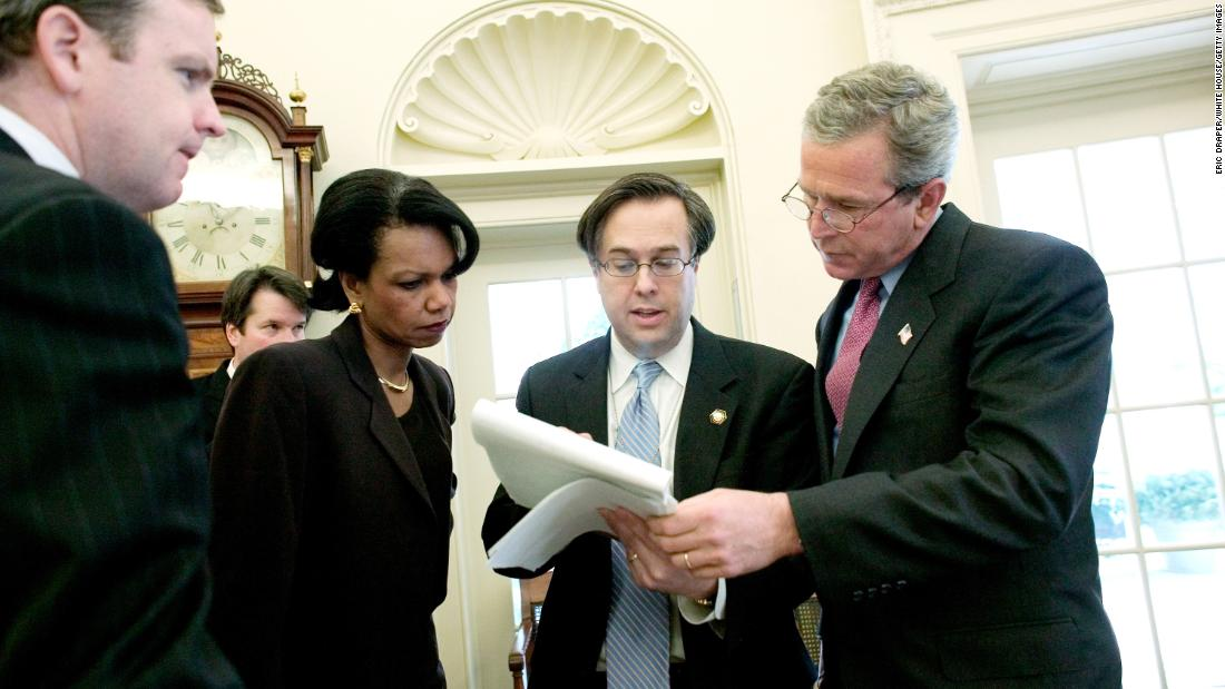 Kavanaugh stands behind National Security Adviser Condoleezza Rice as President George W. Bush, right, reviews his State of the Union speech in January 2004.