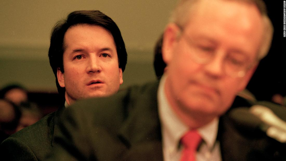 Kavanaugh sits behind Kenneth Starr as Starr testifies before a House committee in November 1998. Kavanaugh worked on Starr's investigation of President Bill Clinton.