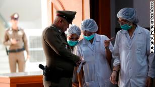 Thai hospital staff and a police officer at Chiangrai Prachanukroh Hospital in Chiang Rai province, Thailand, 10 July 2018.