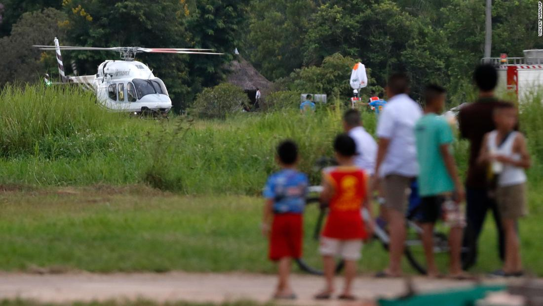 A helicopter believed to be carrying one of the boys rescued from the flooded caves.