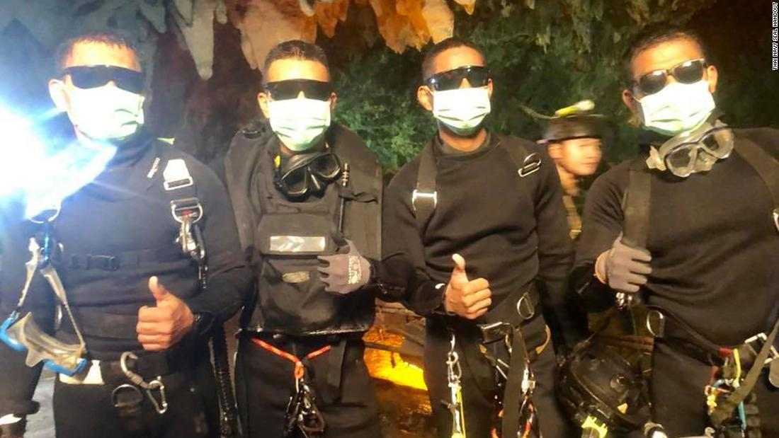 Thai Navy SEALs who helped save a trapped youth soccer team from a flooded cave pose for a photo after rescue efforts were finished on Tuesday, July 10. One of the SEALs was a doctor who stayed with the team for a week after the group was found alive on July 2.