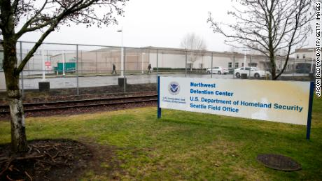 Migrants describe hunger and solitary confinement at for-profit detention center