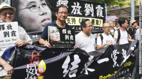 On July 1, 2018, people in Hong Kong protest in a democratic protest and call on China to dismiss Liu Xia, the widow of China, Nobel Peace Prize winner Liu Xiaobo, who has been under house arrest for years