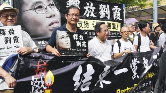 People march in Hong Kong in democracy protest on July 1, calling on China to release Liu Xia, the widow of China's late Nobel Peace Prize laureate Liu Xiaobo, who has been under house arrest for years.