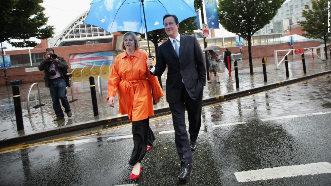 "May joins then-Conservative Party leader <a href=""https://www.cnn.com/2012/12/13/world/europe/david-cameron---fast-facts/index.html"" target=""_blank"">David Cameron</a> during a party conference in Manchester, England, in October 2009. Cameron became Prime Minister the following year, and May was appointed home secretary."