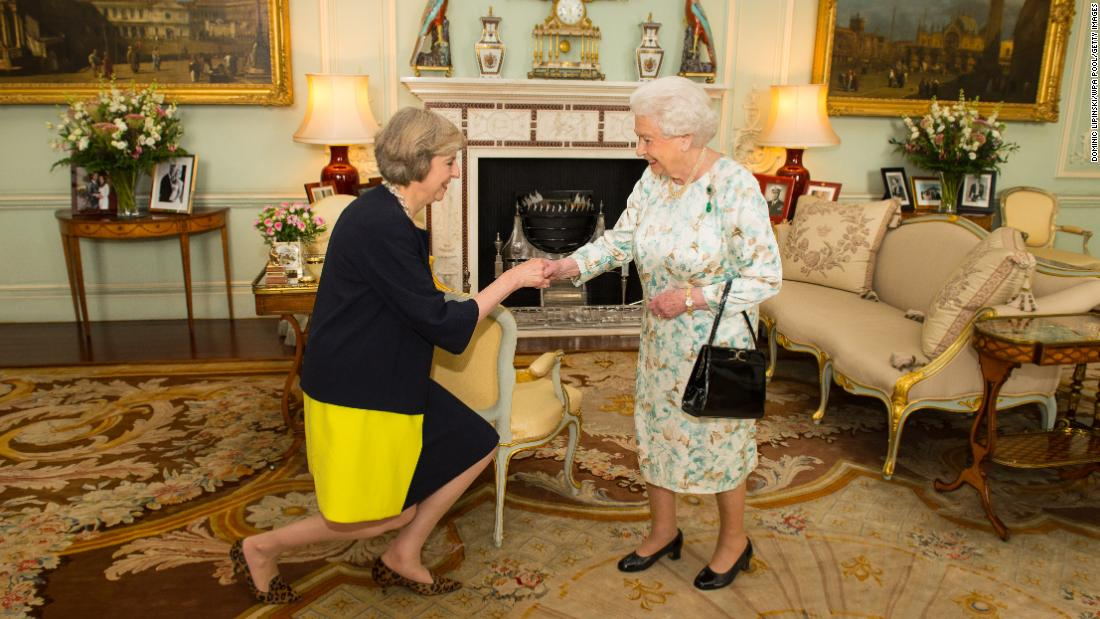 Queen Elizabeth II welcomes May at Buckingham Palace on the day she became Prime Minister.