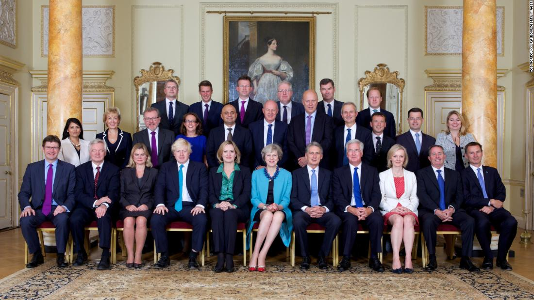 May, in the center of the front row, with members of her Cabinet in September 2016.