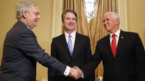 WASHINGTON, DC - JULY 10:  Judge Brett Kavanaugh (C) stands by as Senate Majority Leader Mitch McConnell (R-KY) (L) greets Vice President Mike Pence (R) before a meeting in McConnell