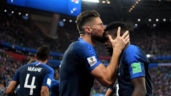 France's Olivier Giroud kisses teammate Samuel Umtiti after Umtiti scored on a header against Belgium.