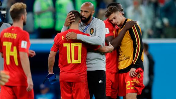 Thierry Henry, assistant coach for Belgium and former French captain, consoles Belgian players after the semifinal loss.