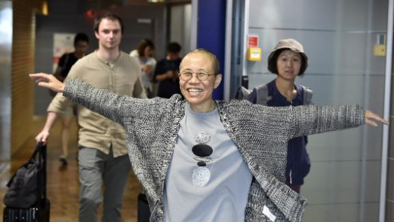 Liu Xia, the widow of Chinese Nobel dissident Liu Xiaobo, smiles as she arrives at the Helsinki International Airport in Vantaa, Finland, on Tuesday.