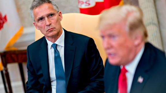 Jens Stoltenberg, secretary general of the North Atlantic Treaty Organization (NATO), listens as U.S. President Donald Trump, right, speaks during a meeting in the Oval Office of the White House May 17, 2018 in Washington, DC. The White House said the two leaders will be discussing the upcoming NATO Summit in July. (Photo by Andrew Harrer-Pool/Getty Images)