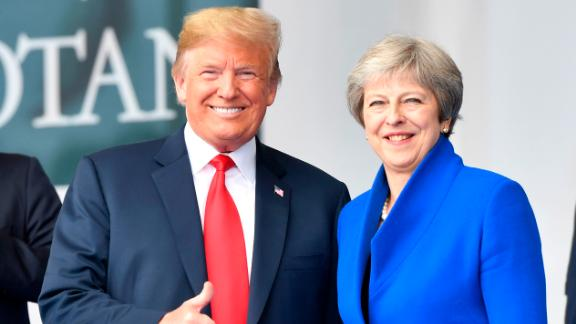 U.S. President Donald Trump gives thumb-up when standing beside British Prime Minister Theresa May during a summit of heads of state and government at NATO headquarters in Brussels on Wednesday, July 11, 2018. NATO leaders gather in Brussels for a two-day summit to discuss Russia, Iraq and their mission in Afghanistan. Geert Vanden Wijngaert/AP