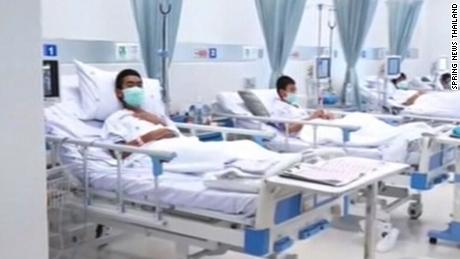 Freed Thai boys in their hospital beds.