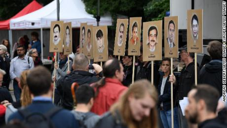 Activists hold banners with the portraits of the NSU victims outside the Munich courthouse Wednesday.