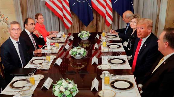 U.S. President Donald Trump, third right, and NATO Secretary General Jens Stoltenberg, third left, speak during their bilateral breakfast, Wednesday, July 11, 2018 in Brussels, Belgium. (AP Photo/Pablo Martinez Monsivais)