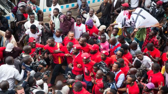 Musician turned politician Robert Kyagulanyi (C) is joined by other activists at the protest in Kampala, Uganda on July 11, 2018. Sumy Sadurni/AFP/Getty Images.