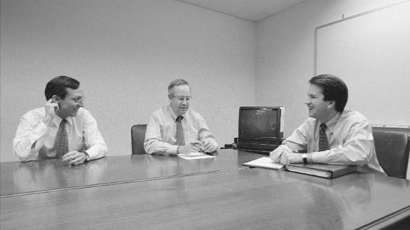 WASHINGTON DC -- NOVEMBER 13: Independent Counsel Kenneth Starr, center, talks with Deputy Independent Counsel John Bates, left, and aide Brett Kavanaugh, right, and another colleague in the Office of the Solicitor General during the Whitewater Investigation on November 13, 1996 in Washington DC. (Photo by David Hume Kennerly/Getty Images)