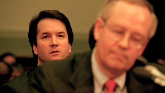 WASHINGTON DC -- NOVEMBER 19: Brett Kavanaugh, associate counsel in the Office of Independent Counsel Kenneth Starr, sits behind Starr during his testimony before the House Judiciary Committee regarding the possible impeachment of President Bill Clinton on November 19, 1998 in Washington DC. (Photo by David Hume Kennerly/Getty Images)