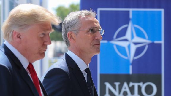 US President Donald Trump (L) walks with NATO Secretary General Jens Stoltenberg as he arrives to attend the NATO (North Atlantic Treaty Organization) summit, in Brussels, on July 11, 2018. (TATYANA ZENKOVICH/AFP/Getty Images)