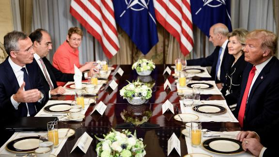 NATO Secretary General Jens Stoltenberg (L), US President Donald Trump (R), NATO Assistant Secretary General for Political Affairs and Security Policy Alejandro Alvargonzalez (2L), NATO Spokesperson Oana Lungescu (3L) and White House Chief of Staff John Kelly (3R) and US Ambassador to NATO Kay Bailey Hutchison (2R) speak at a breakfast meeting at the US chief of mission's residence in Brussels on July 11, 2018, ahead of a NATO (North Atlantic Treaty Organization) summit. Brendan Smialowski/AFP/Getty Images