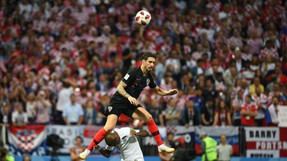 Croatian defender Sime Vrsaljko goes over Ashley Young for a header.