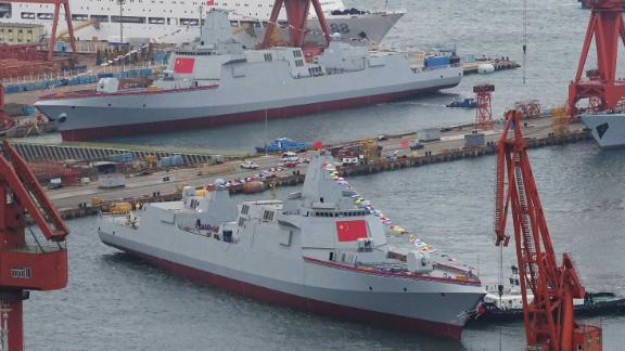 Two Type 055 guided-missile destroyers take water at a shipyard on July 3, 2018 in Dalian, Liaoning Province of China. Type 055 is the newest generation of guided-missile destroyer in China. (Photo by VCG)