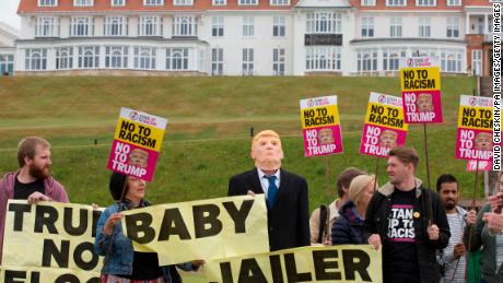 Activists from Stand Up to Racism Scotland (SUTR) stage a protest at the Trump Turnberry resort ahead of the US president's arrival in the UK.