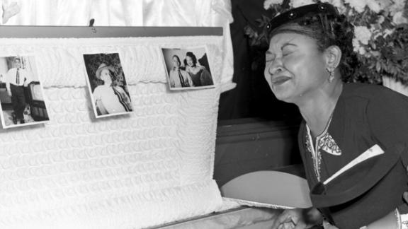 ** ADVANCE FOR SUNDAY, MARCH 11 **FILE**Mamie Till Mobley weeps at her son's funeral on Sept. 6, 1955, in Chicago. The mother of Emmett Till insisted that her son's body be displayed in an open casket forcing the nation to see the brutality directed at blacks in the South at the time.  The FBI announced May 4,2005, that Till's body will be exhumed to conduct an autopsy, which was never performed, and determine the cause of death. The boy was slain in 1955 during a visit to rural Mississippi. (AP Photo/Chicago Sun-Times)