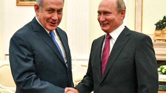 Russian President Vladimir Putin (R) shakes hands with Netanyahu during their meeting at the Kremlin in Moscow on July 11.