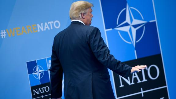 US President Donald Trump waves after being welcomed by the NATO Secretary General for the NATO (North Atlantic Treaty Organization) summit at the NATO headquarters in Brussels on July 11, 2018. (BRENDAN SMIALOWSKI/AFP/Getty Images)