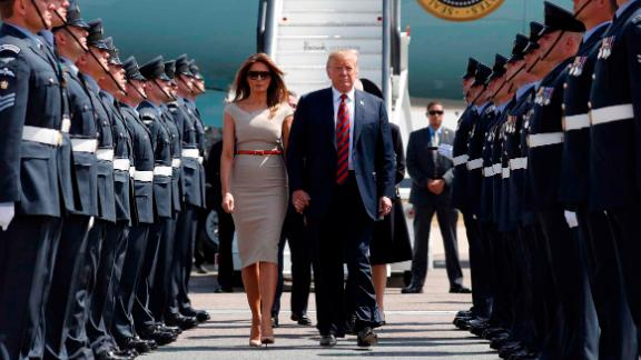 Donald Trump and first lady Melania Trump step off Air Force One as they arrive at London