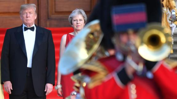Britain's Prime Minister Theresa May (2L) stands with US President Donald Trump (L) on steps in the Great Court watching and listening to the bands of the Scots, Irish and Welsh Guards perform a ceremonial welcome as they arrive for a black-tie dinner with business leaders at Blenheim Palace, west of London, on July 12, 2018, on the first day of President Trump's visit to the UK. - The four-day trip, which will include talks with Prime Minister Theresa May, tea with Queen Elizabeth II and a private weekend in Scotland, is set to be greeted by a leftist-organised mass protest in London on Friday. (Photo by Ben STANSALL / POOL / AFP)        (Photo credit should read BEN STANSALL/AFP/Getty Images)