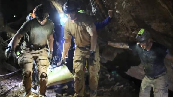 "Rescue personnel  carry a member of the ""Wild Boars"" Thai youth football team on a stretcher during the rescue operation inside the Tham Luang cave."