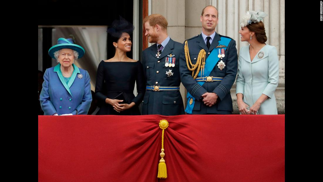 Members of the British royal family stand together at Buckingham Palace to watch a Royal Air Force flyover on Tuesday, July 10. From left are Queen Elizabeth II; Meghan, the Duchess of Sussex; Prince Harry; Prince William; and Catherine, the Duchess of Cambridge.
