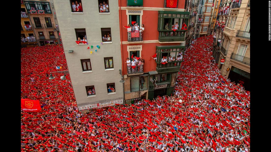 Revelers enjoy the opening day of the San Fermin festival in Pamplona, Spain, on Friday, July 6. The festival is famous for its annual Running of the Bulls.
