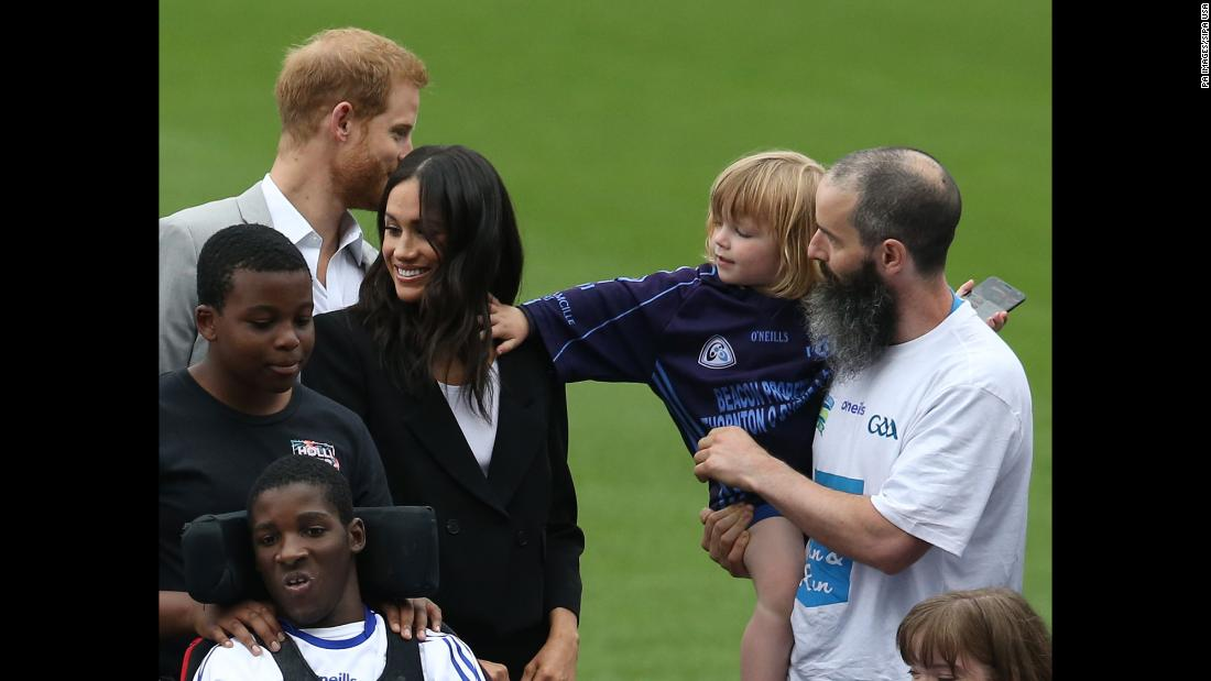 Walter Cullen, 3, reaches out to touch the hair of Meghan, the Duchess of Sussex, who was visiting Dublin, Ireland, with her husband, Prince Harry, on Wednesday, July 11. It was Harry and Meghan's first official trip together since getting married in May.