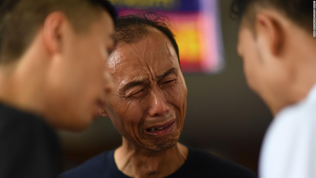 A man cries Sunday, July 8, at a hospital in Phuket, Thailand, where Chinese tourists were being treated after their boats capsized and sank in a huge storm. More than 40 people were killed.