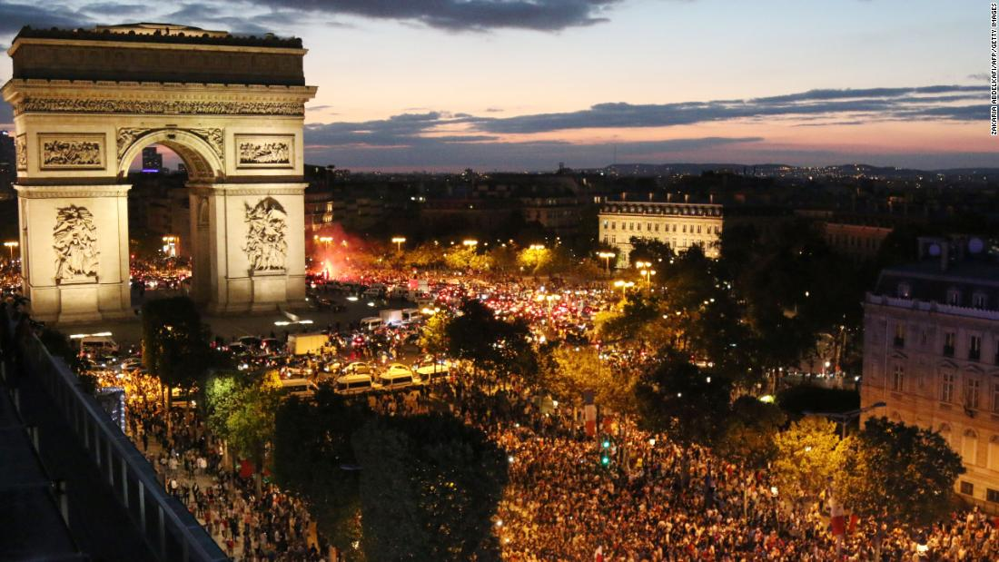People celebrate in Paris after France won its World Cup semifinal against Belgium on Tuesday, July 10.