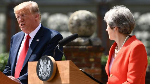 "US President Donald Trump (L) and Britain's Prime Minister Theresa May  hold a joint press conference following their meeting at Chequers, the prime minister's country residence, near Ellesborough, northwest of London on July 13, 2018 on the second day of Trump's UK visit. - Britain and the United States have agreed to pursue ""an ambitious UK-US free trade agreement"" after Brexit, Prime Minister Theresa May said on Friday following talks with US President Donald Trump. (Photo by Brendan Smialowski / AFP)        (Photo credit should read BRENDAN SMIALOWSKI/AFP/Getty Images)"