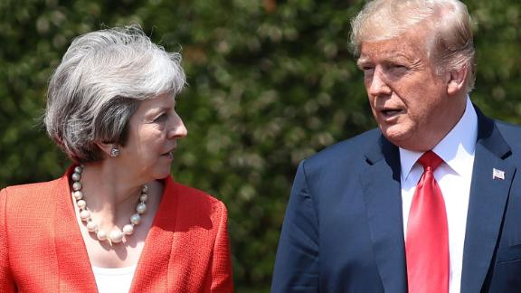 "US President Donald Trump (R) and Britain's Prime Minister Theresa May (L) walk together after holding a meeting at Chequers, the prime minister's country residence, near Ellesborough, northwest of London on July 13, 2018 on the second day of Trump's UK visit. - US President Donald Trump launched an extraordinary attack on Prime Minister Theresa May's Brexit strategy, plunging the transatlantic ""special relationship"" to a new low as they prepared to meet Friday on the second day of his tumultuous trip to Britain. (Photo by Jack Taylor / POOL / AFP)        (Photo credit should read JACK TAYLOR/AFP/Getty Images)"