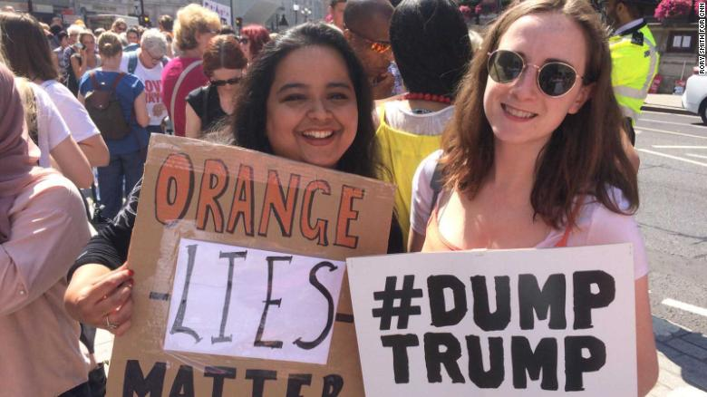 Ana Damale, 23, left, and Alice Stevenson, 24, from London say they are against Trump's policies.