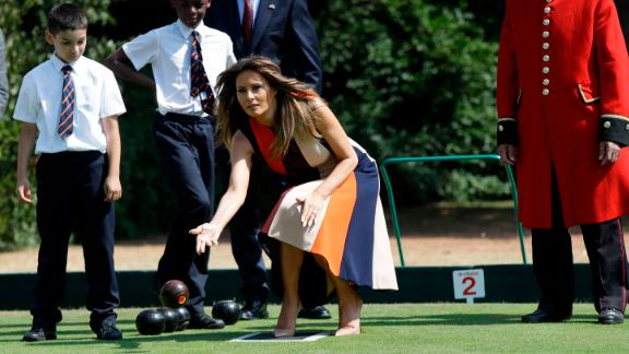 "LONDON, ENGLAND - JULY 13: U.S. First Lady Melania Trump plays bowls she meets British military veterans known as ""Chelsea Pensioners"" at Royal Hospital Chelsea on July 13, 2018 in London, England. America's First Lady visited the Chelsea Pensioners while her husband, President Donald Trump, held bi-lateral talks with Theresa May at the Prime Minister's Country Residence.  The Chelsea Pensioners are British Army personnel who are cared for at at the Services retirement home at The Royal Hospital in London. (Photo by Luca Bruno - WPA Pool/Getty Images)"