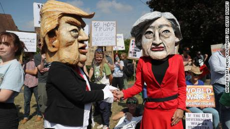 Protestors wearing Donald Trump and Theresa May costumes protest near the Prime Minister's country residence at Chequers in Buckinghamshire on Friday.