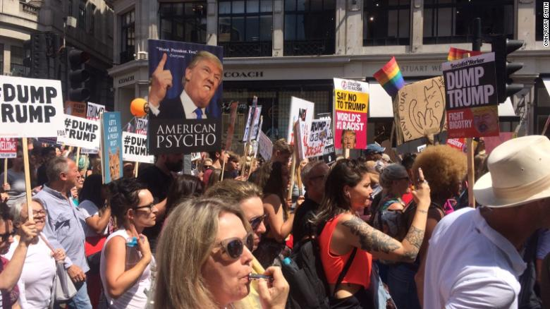 Anti-Trump protesters march down Regent's St in central London on July 13, 2018.