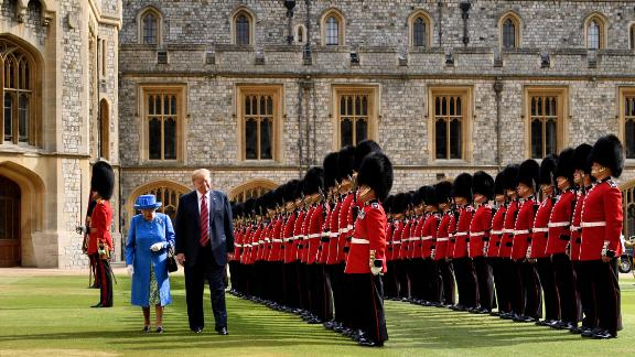US President Donald Trump is accompanied by Britain