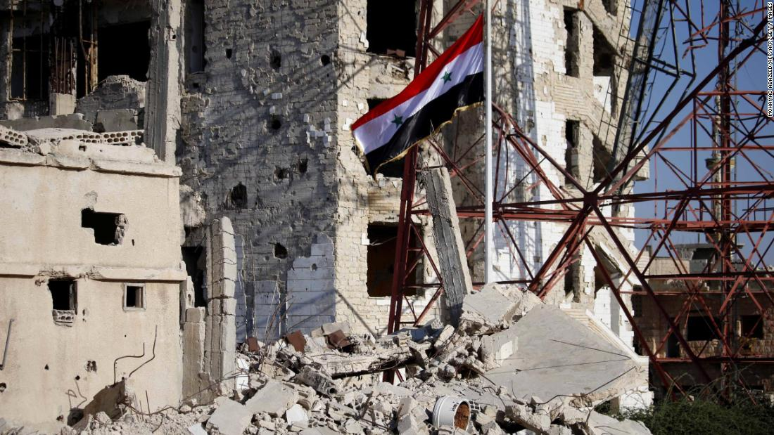 Syrian government forces raise flag in Dara'a, birthplace of the war