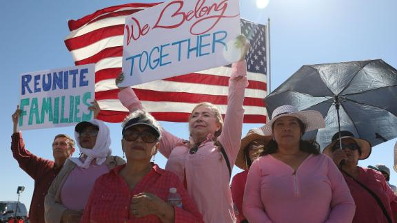FABENS, TX - JUNE 21:  Linda Posada holds up a sign that reads,