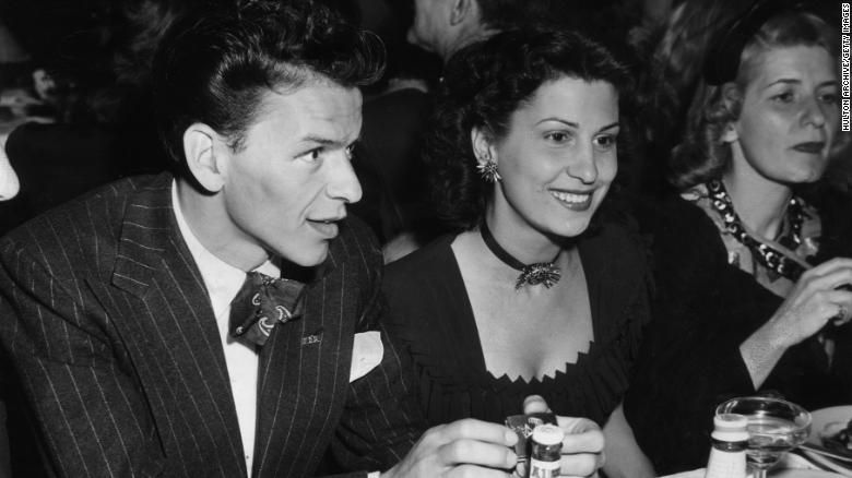 Frank Sinatra at a nightclub next to his first wife, Nancy. The two started dating as teenagers.